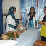 Our polio patient receiving physical therapy